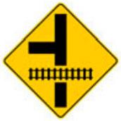 Señal Preventiva SP-35B Intersección Vial en T Próxima a Cruce con Vía Férrea